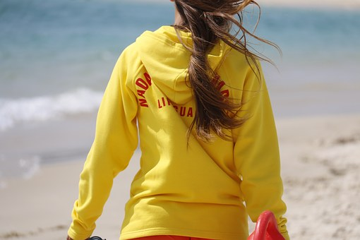 Lady Lifeguard on a beach showing Lifeguard Services in South Africa